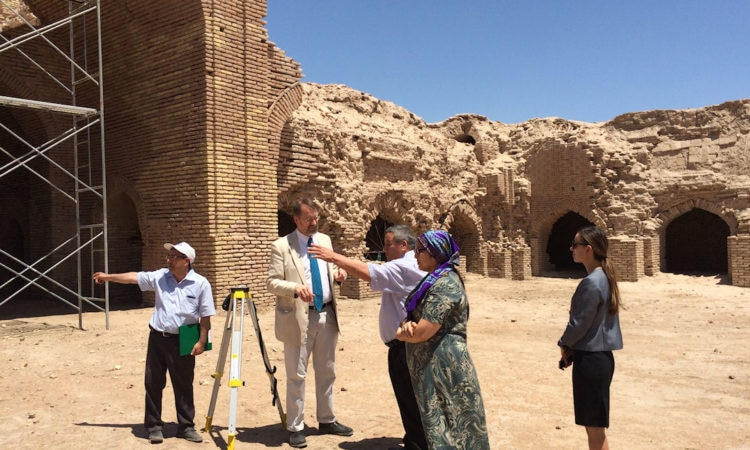 Ambassador touring the XII-century Silk Road caravanserai at Dayahatyn, where restoration work supported by AFCP funding is underway